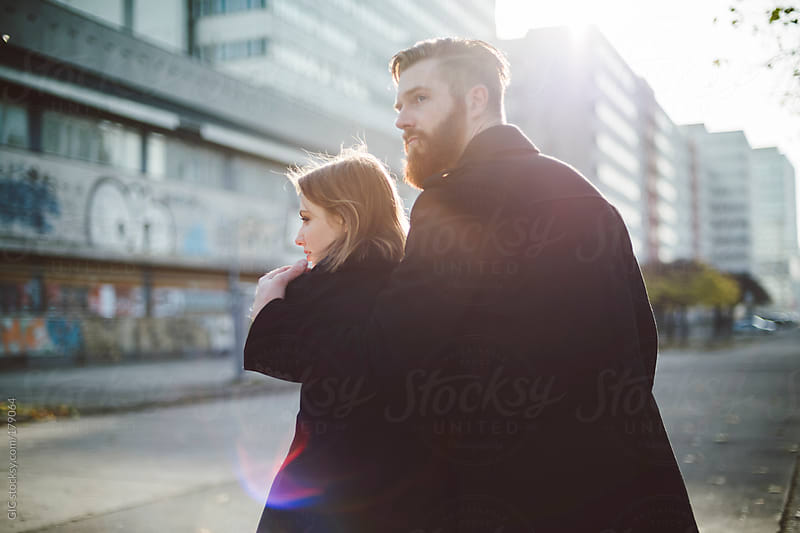 Affectionate couple hugging in the street by GIC for Stocksy United
