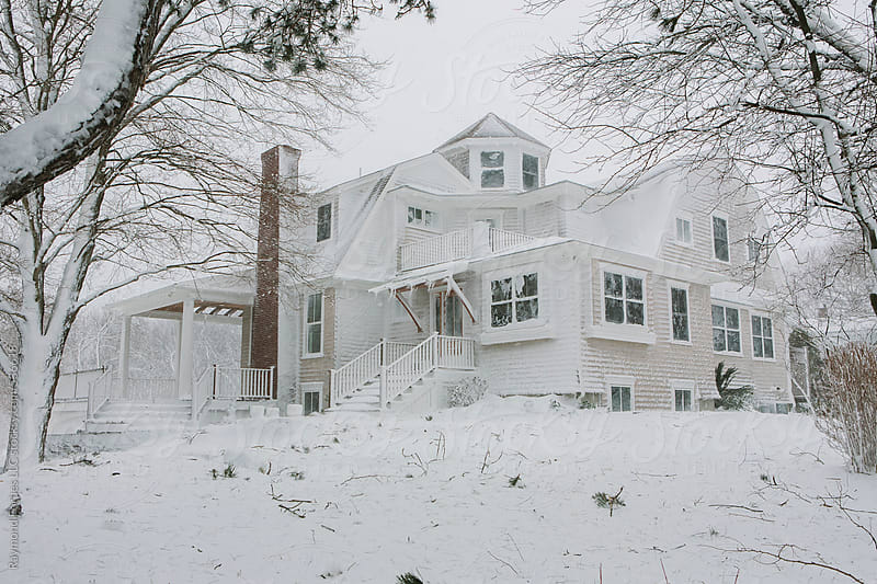 House after Snow Blizzard by Raymond Forbes LLC for Stocksy United