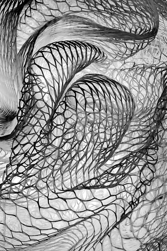 Closeup of plastic mesh material, twists, curves, highlights, shadows by Ron Mellott for Stocksy United