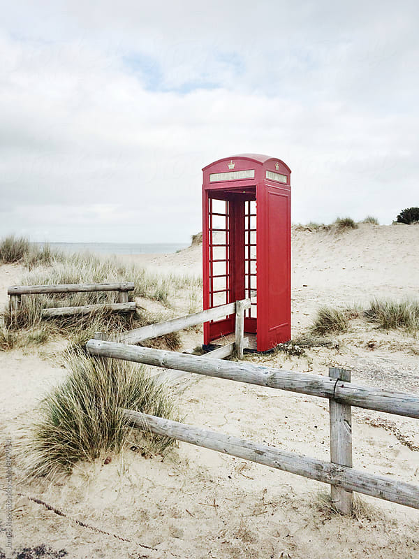 An abandoned telephone box by James Ross for Stocksy United