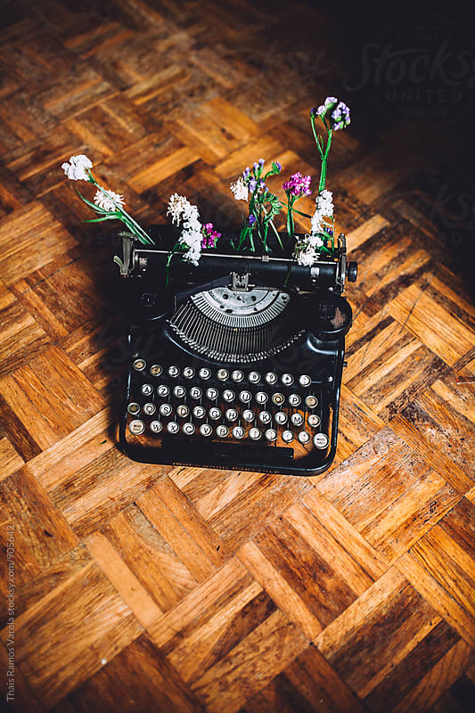 Typewriter with flowers  by Thais Ramos Varela for Stocksy United