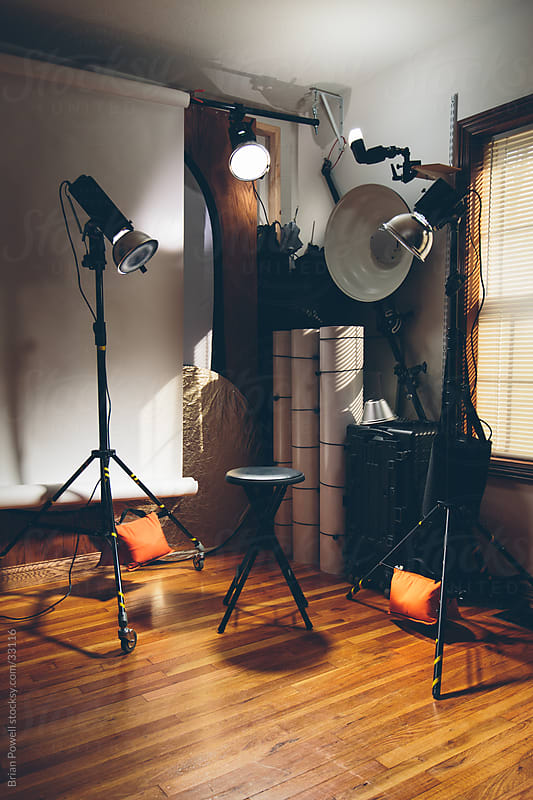 empty photography studio with lighting gear by Brian Powell for Stocksy United