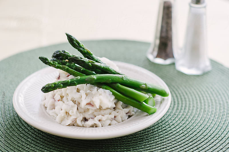 Mashed potatoes and asparagus side dish by Matthew Spaulding for Stocksy United