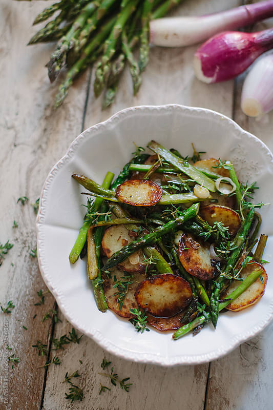 Asparagus and roasted potatoes by Davide Illini for Stocksy United