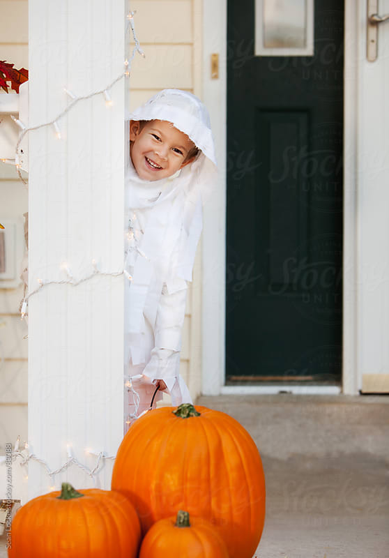 Halloween: Boy Standing On Porch As Mummy by Sean Locke for Stocksy United