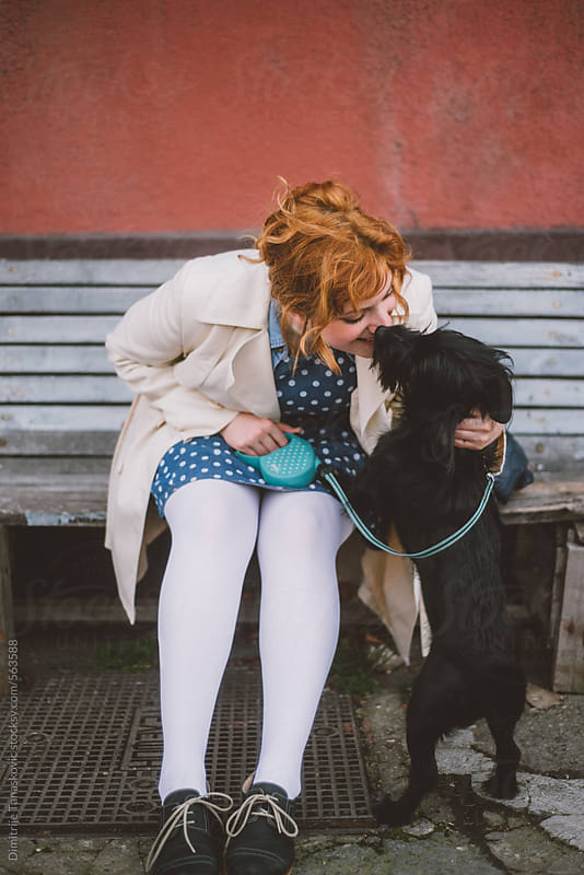 Woman and dog by Dimitrije Tanaskovic for Stocksy United