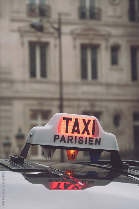 Parisian Taxi  by B & J for Stocksy United