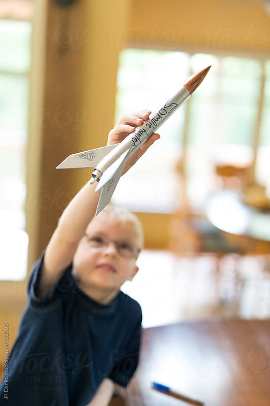 Creative Little Boy Rocket Scientist Imagining WIth Home Made Model Rocket Ready for Flight by JP Danko for Stocksy United
