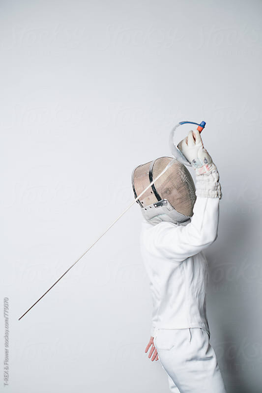 Woman in white fencing costume holding sabre by Danil Nevsky for Stocksy United
