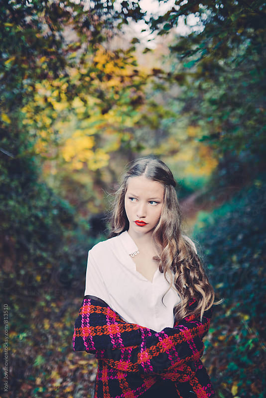 Young girl enjoying nature in autumn by Koki Jovanovic for Stocksy United
