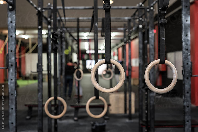 gymnastic rings in a crossfit gym by Guille Faingold for Stocksy United