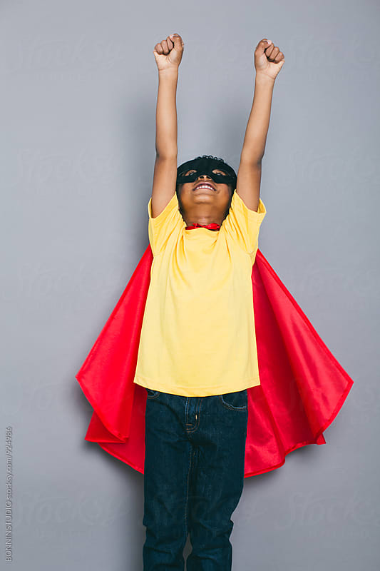 Funny little boy with Superhero costume. by BONNINSTUDIO for Stocksy United