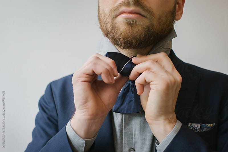 Men's Fashion - Close Up of Blond Caucasian Man Tying Bow Tie by Julien L. Balmer for Stocksy United