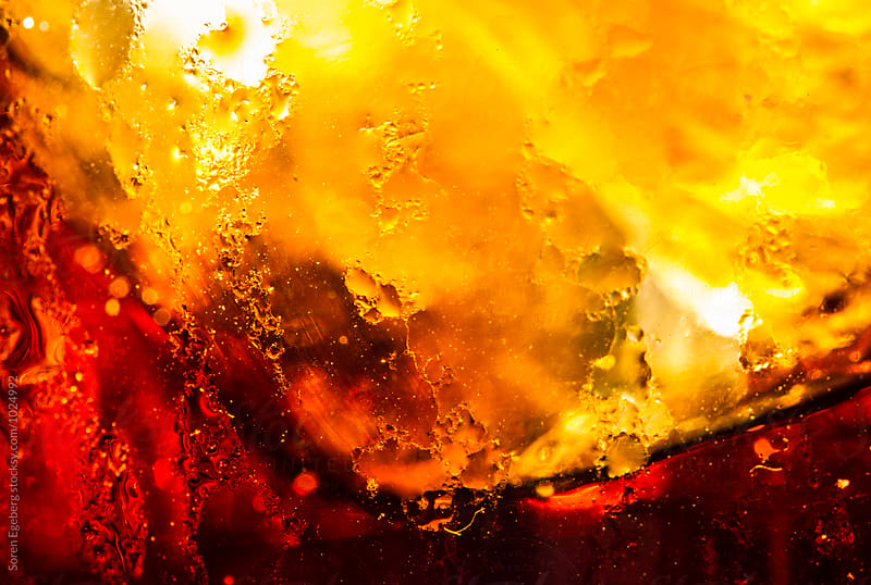 Ice cold glass of cola closeup by Søren Egeberg Photography for Stocksy United