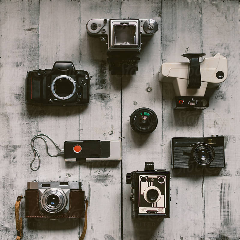 The Old Cameras on a White Board by Branislav Jovanović for Stocksy United