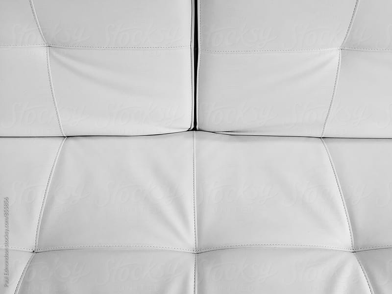 Detail of modern & minimalist white leather chair by Paul Edmondson for Stocksy United