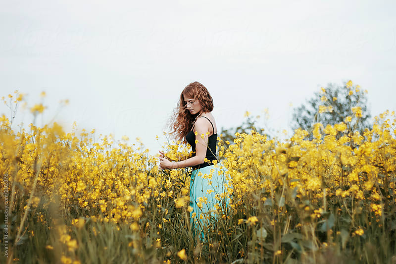Beautiful young woman among the flowers by Jovana Rikalo for Stocksy United