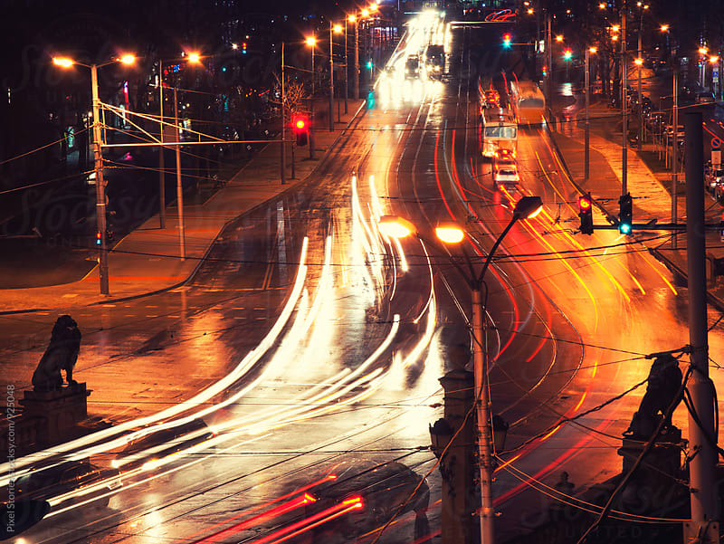 Headlight trails on street by Pixel Stories for Stocksy United