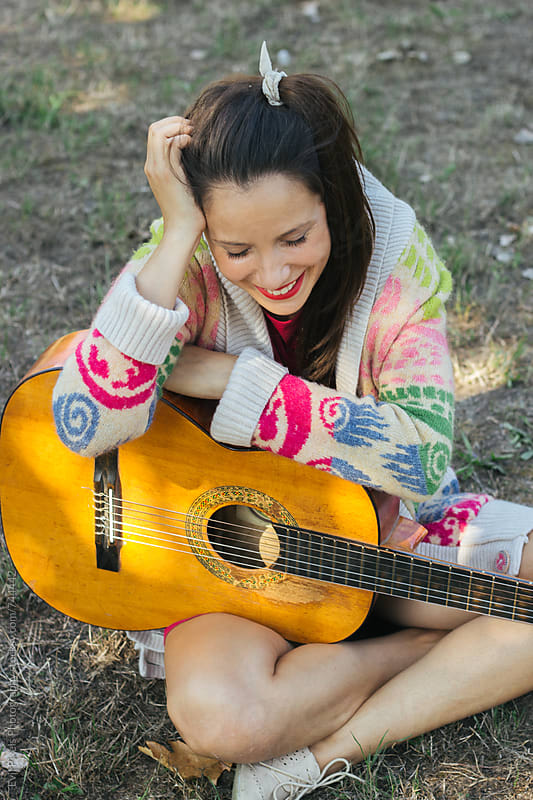 Portrait of a young female model with guitar outdoor by Evil Pixels Photography for Stocksy United