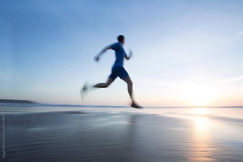 Runner on Beach at sunset. by Hugh Sitton for Stocksy United
