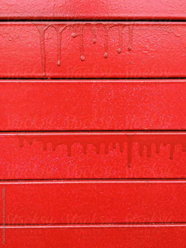 Close up of red paint on urban wall by Paul Edmondson for Stocksy United