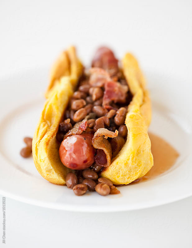 Hot Dog with Baked Beans, Bacon and Maple Syrup by Jill Chen for Stocksy United