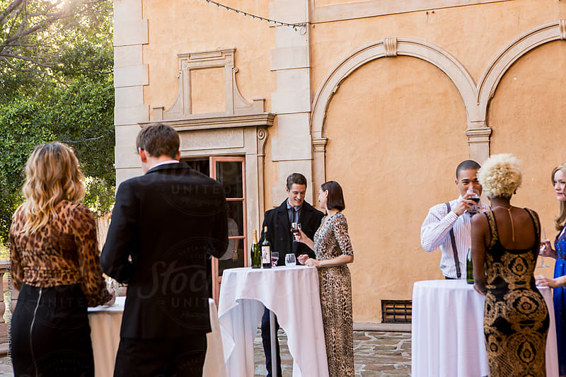 Group of People at a Formal Outdoor Party by Jayme Burrows for Stocksy United