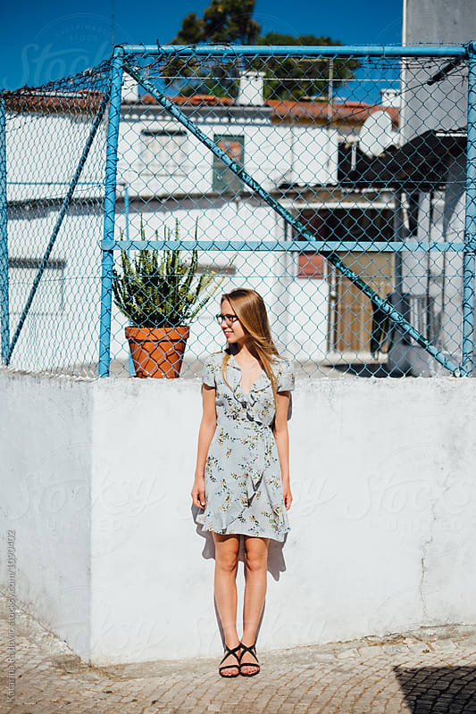 Young Woman Posing in Summer Dress by Katarina Radovic for Stocksy United