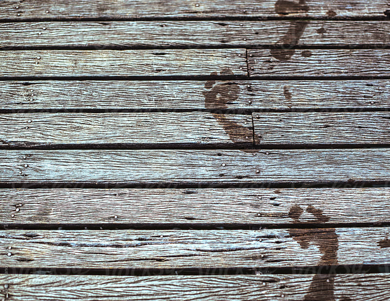 Wet footprint on wooden pier.  by Jovo Jovanovic for Stocksy United