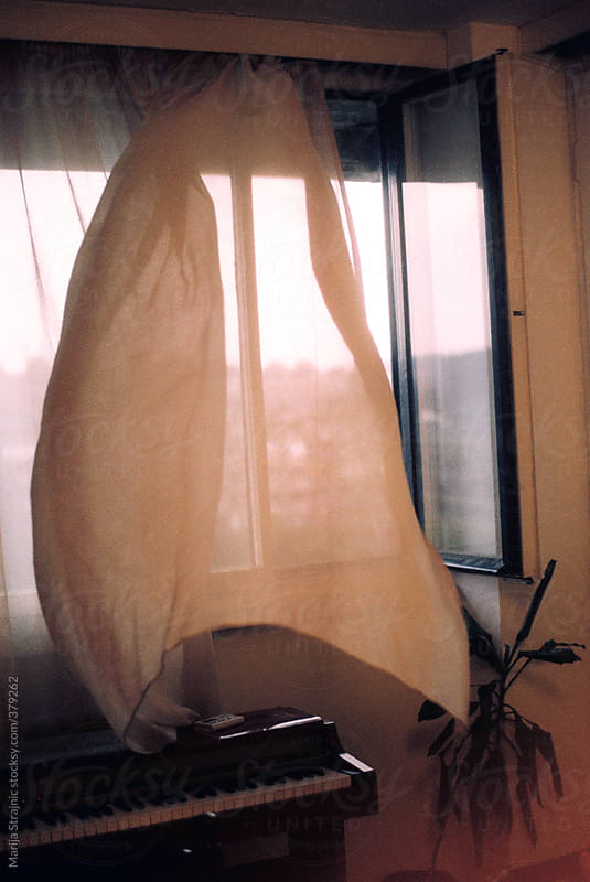 Windy curtain by Marija Strajnic for Stocksy United