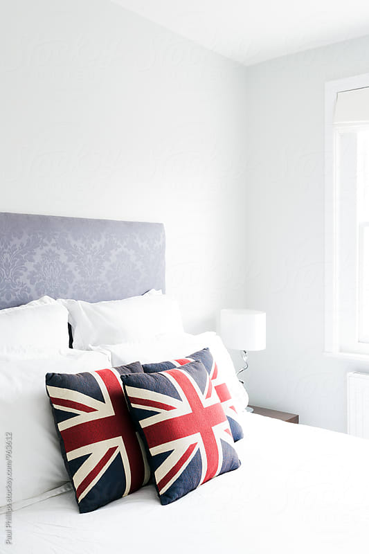 Bedside with cushions showing the Union Jack ( the national flag of the UK ) by Paul Phillips for Stocksy United