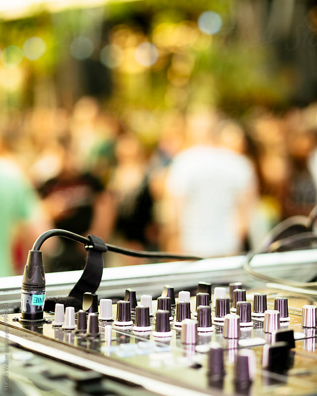 DJ Mixer at an outdoor party by Harald Walker for Stocksy United