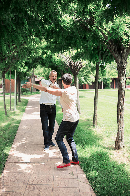 Happy elderly couple dancing in nature by Jovana Rikalo for Stocksy United