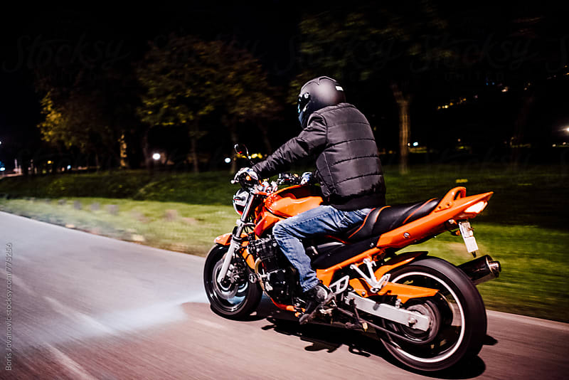 Man riding a motorbike  by Boris Jovanovic for Stocksy United