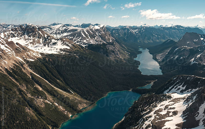 Glacial lakes between mountains of the Canadian Rockies by Riley Joseph for Stocksy United