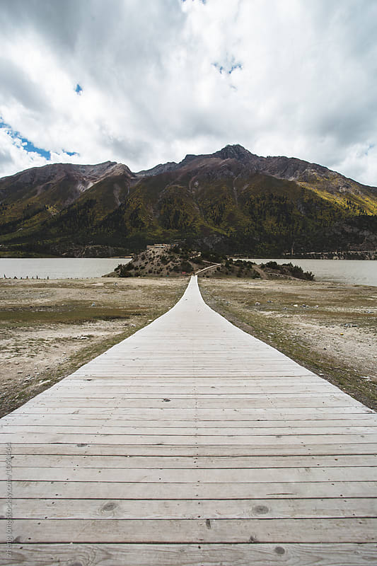 wooden path beside Ranwu lake in Tibet by zheng long for Stocksy United