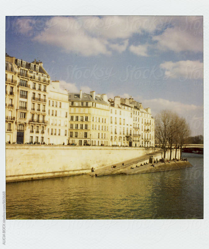 Polaroid Photograph Of People Enjoying A Sunny Day Along The Seine River In Paris France by ALICIA BOCK for Stocksy United