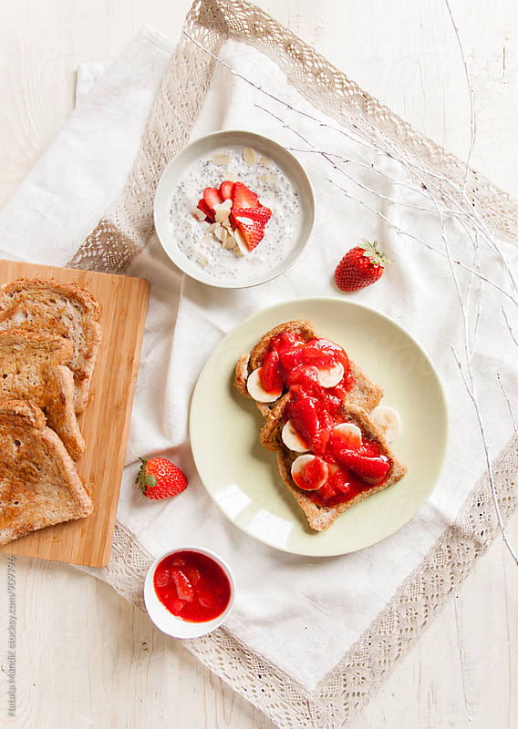 French toast with banana and strawberry compote by Nataša Mandić for Stocksy United