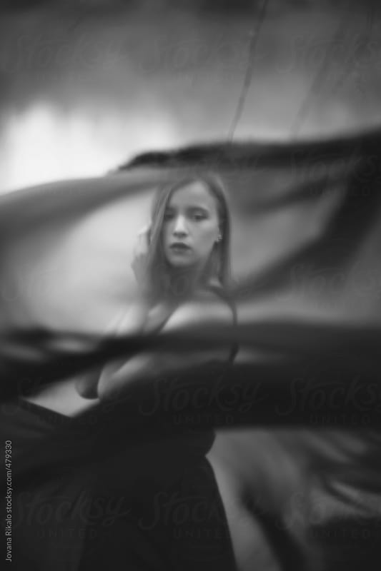 Young woman and black cloak  by Jovana Rikalo for Stocksy United