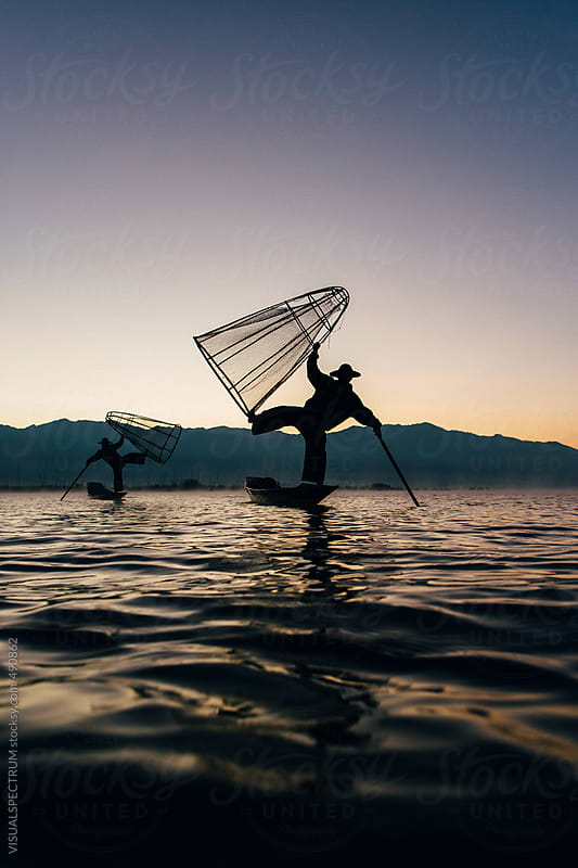 Two Traditional Fishermen on Inle Lake, Burma by VISUALSPECTRUM for Stocksy United