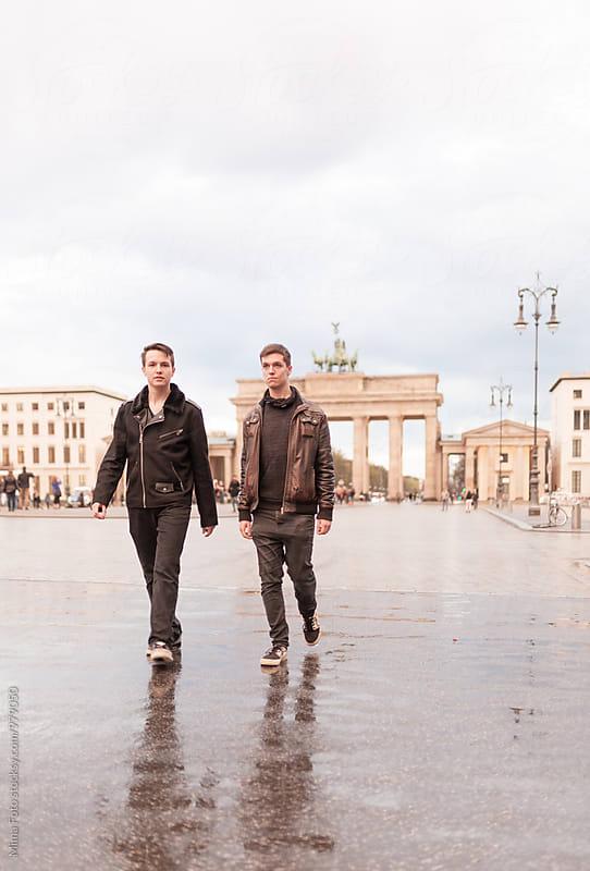 Teenage brothers walking on street at Brandenburg Gate, Berlin, Germany by Michael Zwahlen for Stocksy United