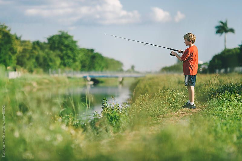 Boy Fishing by Stephen Morris for Stocksy United