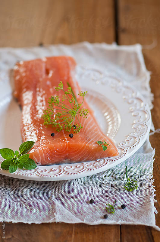 fillet of salmon with herbs by Laura Adani for Stocksy United
