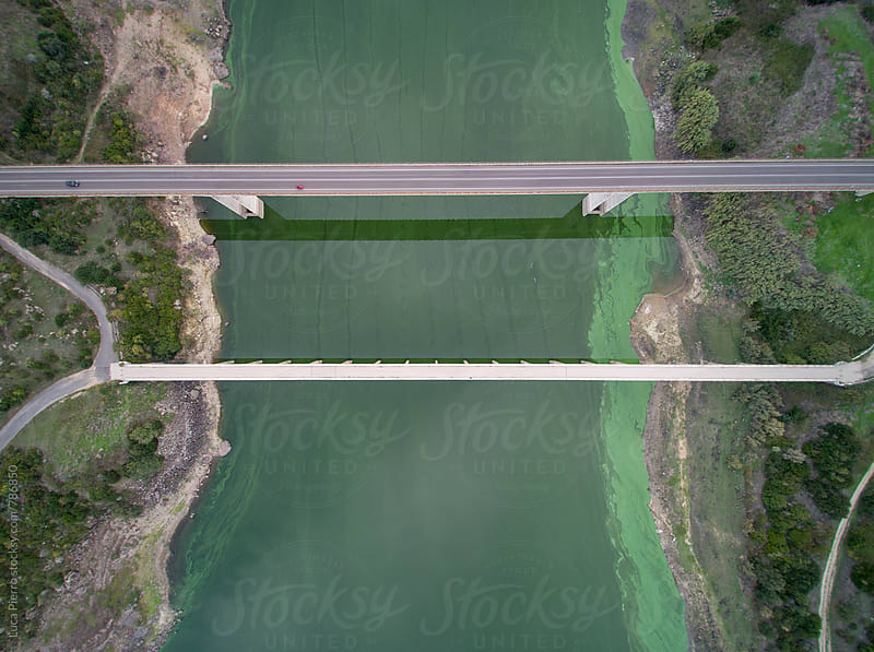 Aerial view of bridges across a river by Luca Pierro for Stocksy United