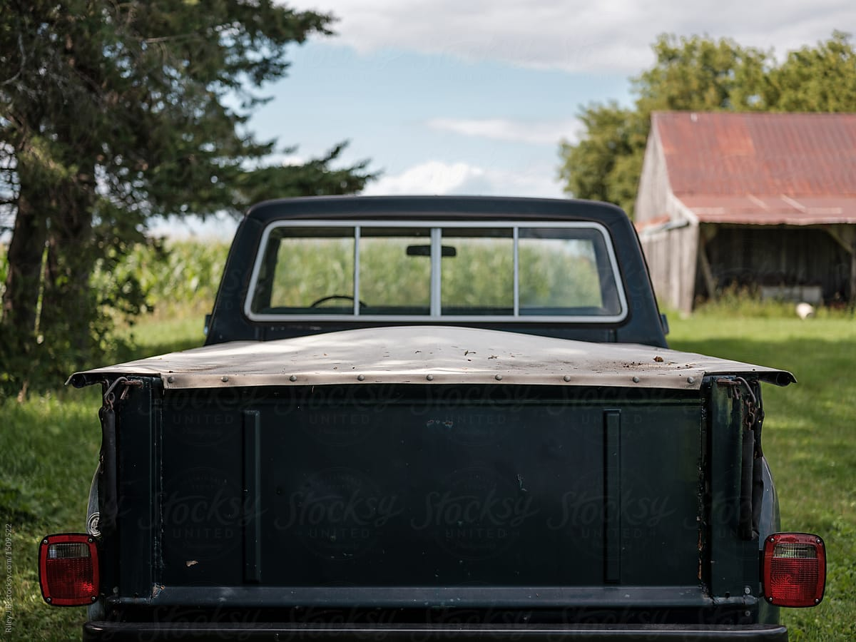 Vintage Pickup Tailgates Old Chevy Truck Tailgate Of A With Canvas Cover Over Bed Riley For Stocksy 1200x900