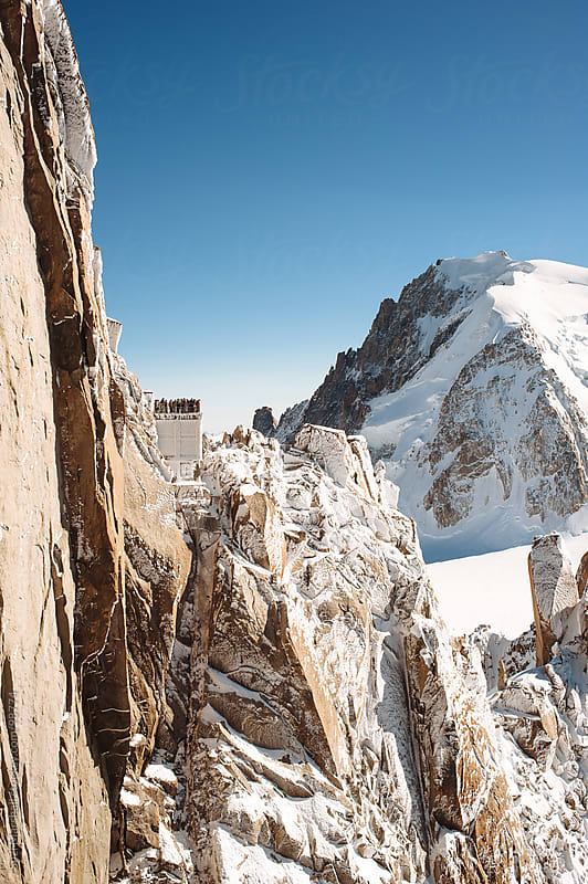 People standing on a viewing platform on Aiguille du Midi mountain by Suzi Marshall for Stocksy United