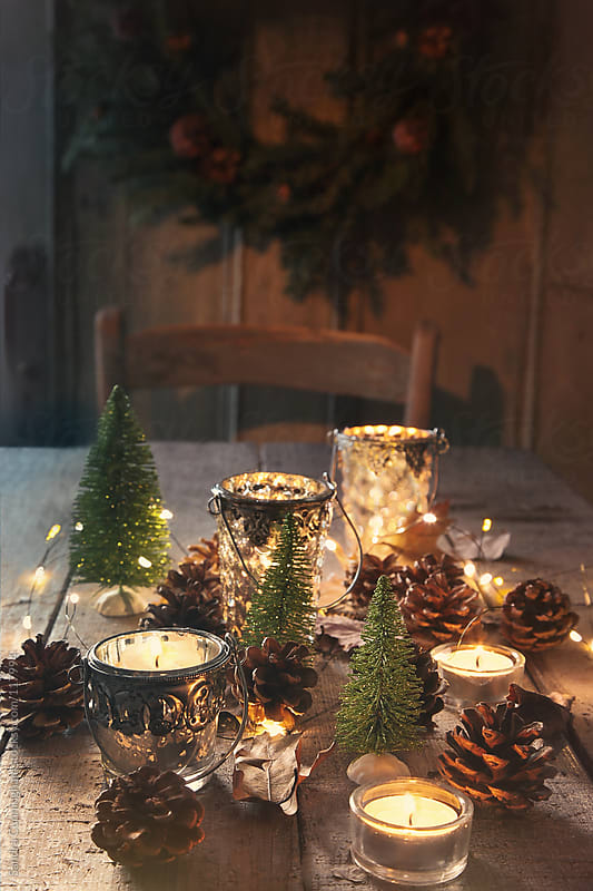 Still life of candles and decorations for the holidays by Sandra Cunningham for Stocksy United