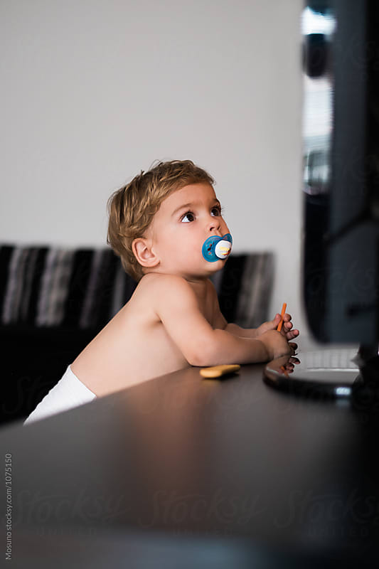 Little Boy Watching TV by Mosuno for Stocksy United