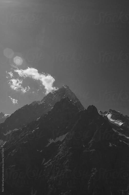 Alpine Peak and Cloud by Neil Warburton for Stocksy United