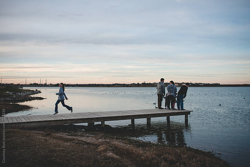 Family time at the lake by Courtney Rust for Stocksy United
